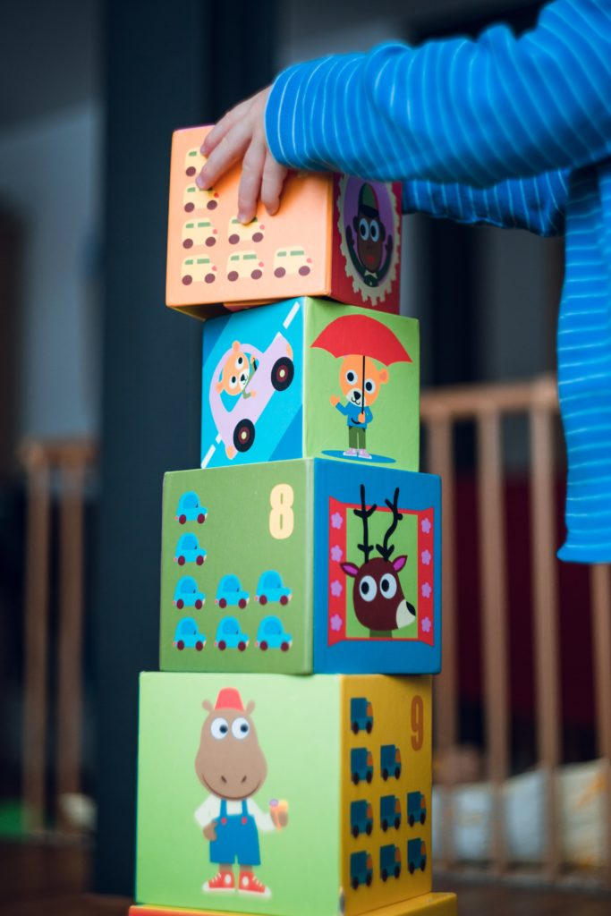 Toy Rotations are beneficial for children of all ages. This toddler building with blocks can better focus without distractions of too many toys.